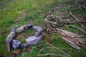 Stones, kindling, sticks and a couple of logs for later.