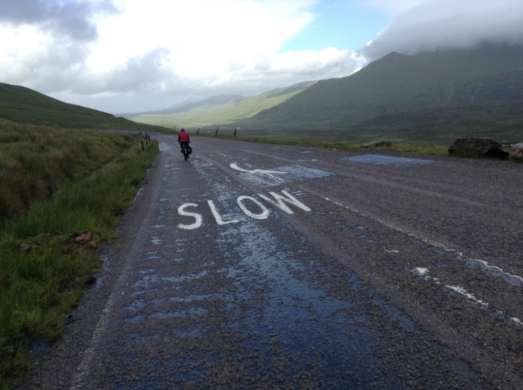 Paint on road describes average speed of wearily, cold cyclist